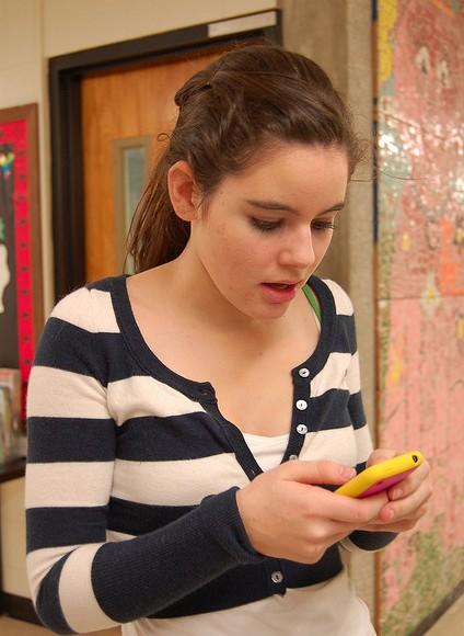 Girl looking at phone.
